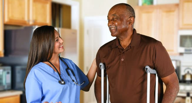 senior man happy with his caregiver
